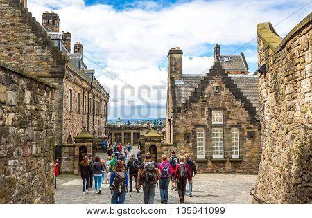 Edinburgh Scotland - July 28 2012: Tourists between the medieval houses of the Edinburgh castle.