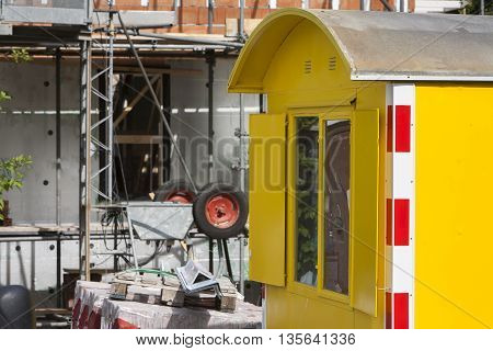 Yellow shed on a construction site in the Netherlands