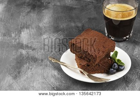 Brownie Pieces And Coffee On A Dark Background