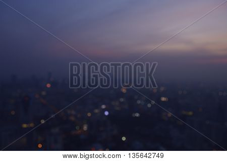 Blurred aerial view of cityscape on warm light sundown