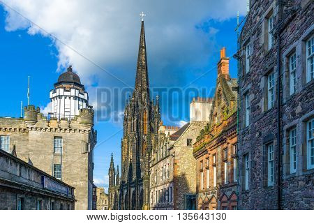 Edinburgh Scotland - June 19 2012: Royal Mile the Camera Obscura and the Hub tower in the background.