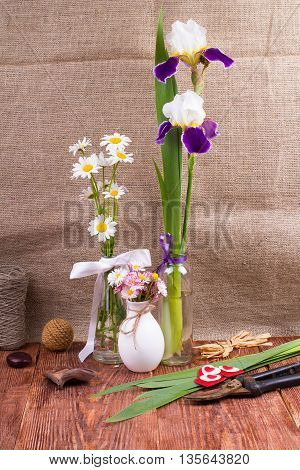 Flowers and garden tools on a table