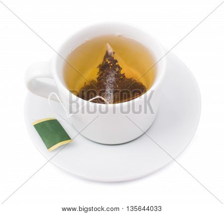 Tea bag in a white cup on a white background