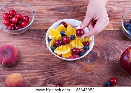 The Person Cooks Fruit Salad.