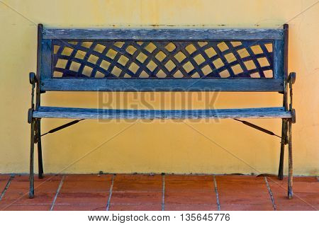 old decorated iron bench and worn wooden use and time