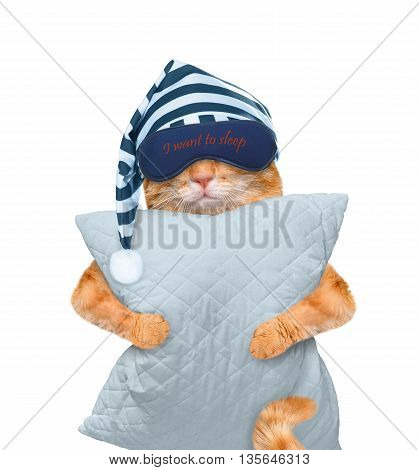 Cat with a mask for sleeping with a pillow. Isolated on white.
