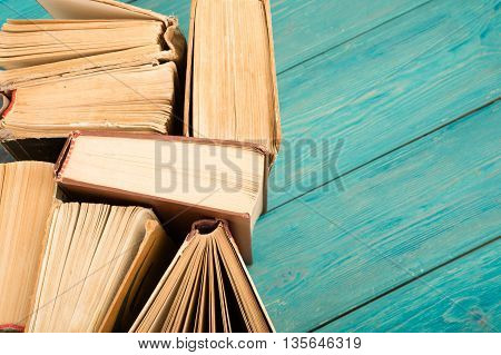 Old And Used Hardback Books Or Text Books On Blue Wooden Desk