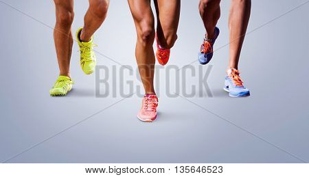 Close up of sportsman legs running against grey vignette