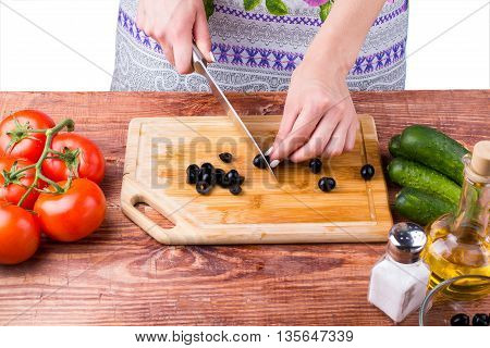 The Girl Cuts Olives
