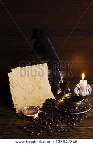 grains and cup of coffee with a candle on a wooden background