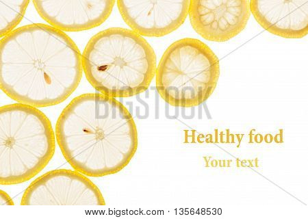 Decorative frame from circles of lemon slices on a white background. Isolated. Decorative border. Fruit background. Copy space.