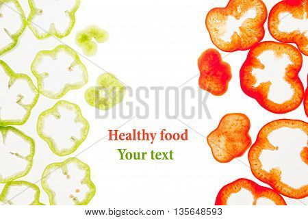 Sliced green and red pepper rings paprika on a white background. Decorative frame of pepper. Isolated. Food background. Concept art. Copy space.
