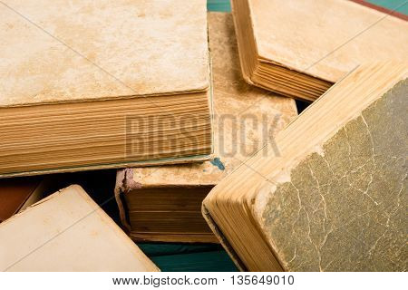 Scattered old and used hardback books or text books