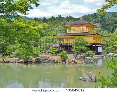Golden pavilion at Kinkaku-ji temple in Kyoto, Japan. Kinkakuji temple is famous tourist attraction in Japan.