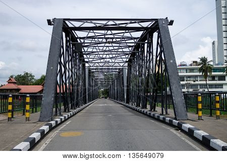 Iron Bridge one of the symbolics of Chiang Mai city located above Mae Ping river. June 22-2016 Chiang Mai Thailand.