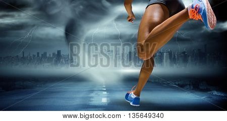 Sporty woman finishing her run against stormy sky with tornado over road