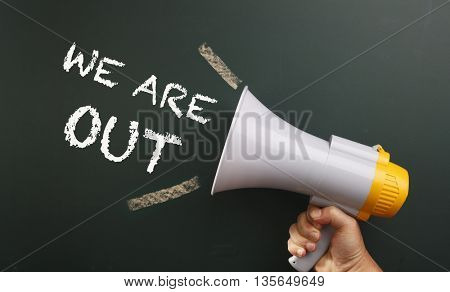megaphone in front chalkboard with text we are out