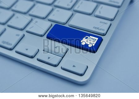 Free delivery truck icon on modern computer keyboard button Transportation business concept blue tone