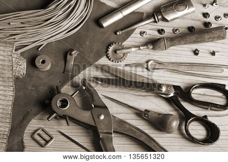 Leather craft tools and buckles - toned image
