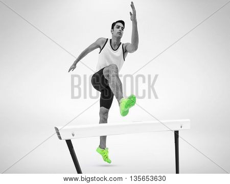 Male athlete running on isolated white background