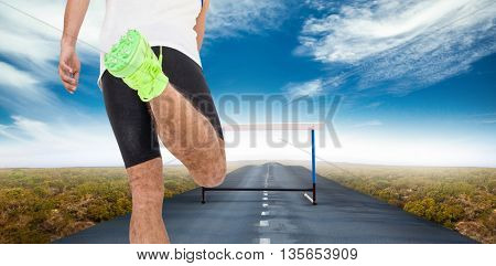 Rear view of male athlete running against view of an empty street