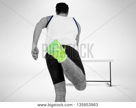 Rear view of male athlete running on isolated white background