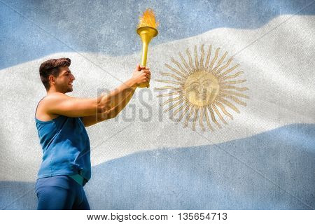 Low angle view of sportsman holding a cup against argentinian flag