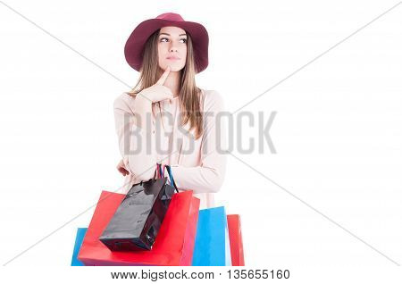 Stylish Young Female Holding Shopping Bags And Thinking At Something