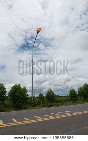 Country Road Street lights ,lamp on the road For safety with blue sky background
