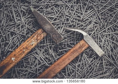 old hammers and nails on the table
