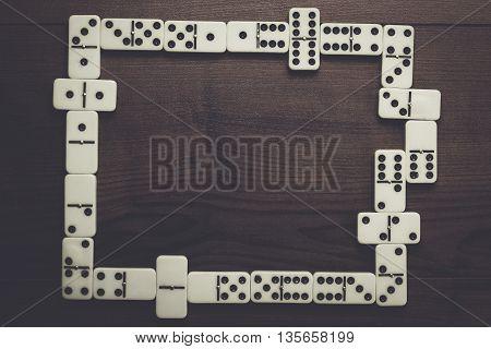 domino pieces on dark brown wooden background