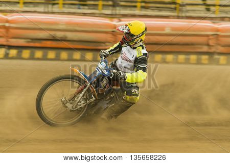 Rivne Ukraine - 11 October 2015: Rider Vladimir Trofimov overcomes the track at the Open Cup Speedway to the day of the city Rivne