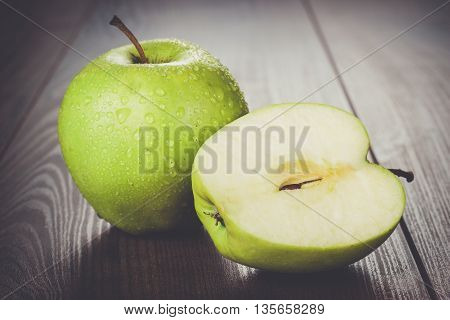 fresh green apples on the wooden table