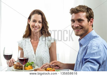 Portrait of happy couple having lunch at home