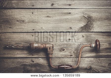 retro hand drill on the wooden table