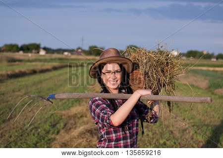Farmer Girl With Basket And Hayfork