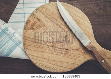 used cutting board on the wooden table