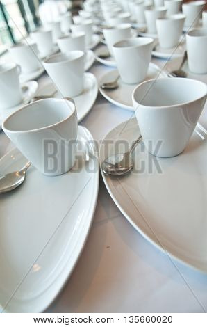Many white cup ready to coffee break