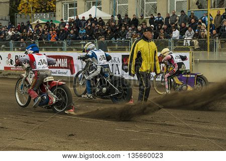 Rivne Ukraine - 11 October 2015: Unknown riders at the start at the Open Cup Speedway to the day of the city Rivne