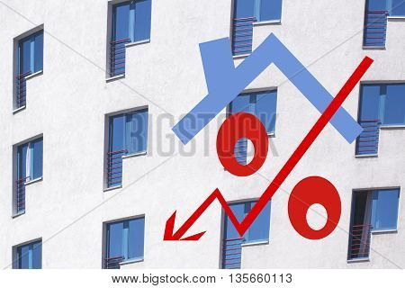 Red percent sign in front of the private house  . The concept of reducing property prices