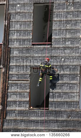 Climber Of Firefighter Climbing A Wall Of A House During The Fir