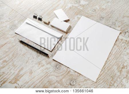 Photo of blank stationery set on light wooden background. For design portfolios. Mock-up for your design.