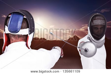 Man wearing fencing suit practicing with sword against composite image of landscape