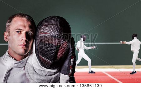 Close-up of swordsman holding fencing mask against digitally generated image of playing field