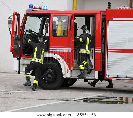 Fire Engine Carrying Two Firefighters For Fighting Fire