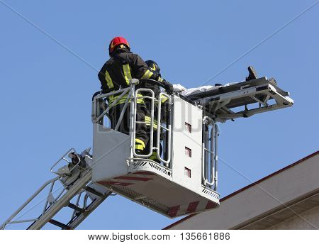 Brave Firefighters On The Fire Truck Cage Save The Wounded Perso