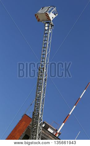 Elevator Cage Of Fire Truck With Big Ladder Of Firemen
