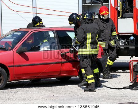 Firefighter Opens Car Door With Pneumatic Shears After The Traff