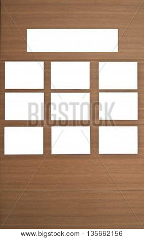 A white blank empty board on wood wall