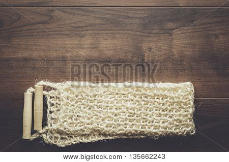 bound bast with wooden grips on the table background